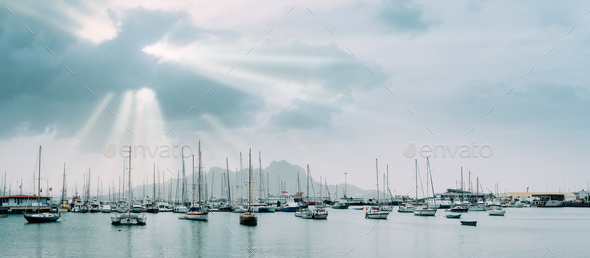 Sailboats and pleasure boats in the porto grande bay of the historic city Mindelo. Sunrays - Stock Photo - Images