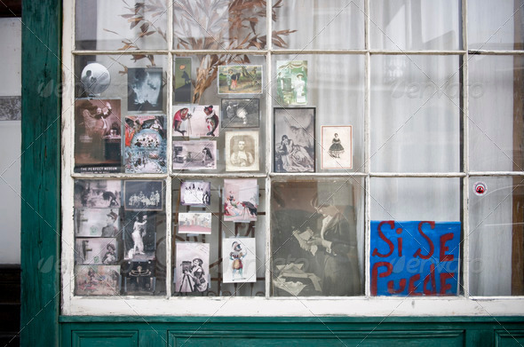 Vintage photographs in window in New Orleans, Louisiana - Stock Photo - Images