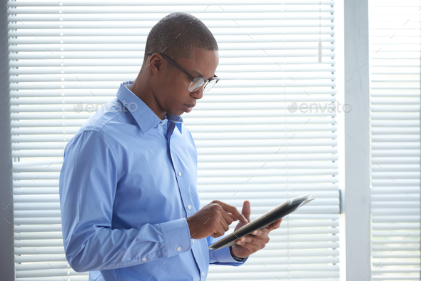 Businessman with digital tablet - Stock Photo - Images