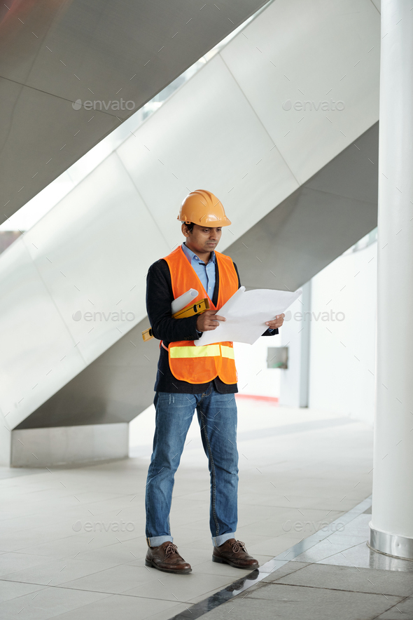 Engineer checking blueprint - Stock Photo - Images