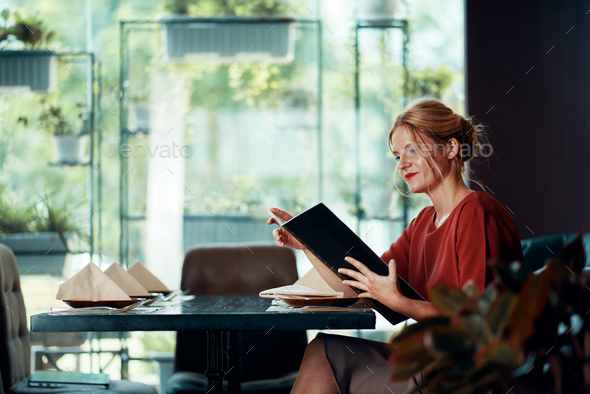 Woman reading menu - Stock Photo - Images