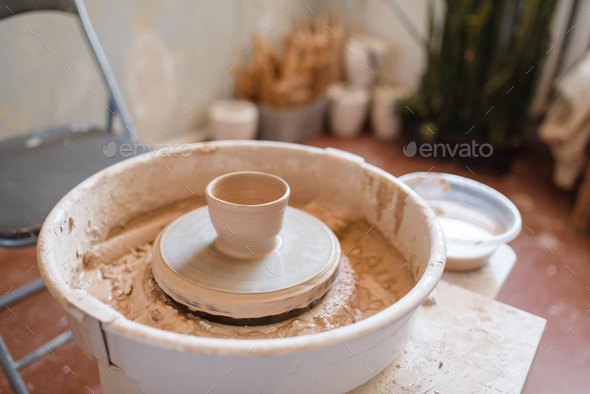 Pottery wheel with clay pot, nobody - Stock Photo - Images