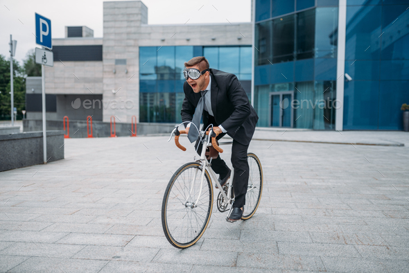 One businessman in funny glasses poses on bicycle - Stock Photo - Images