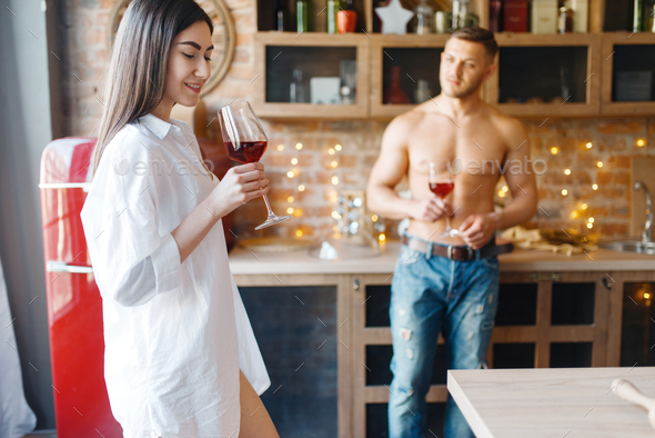 Love couple spend romantic dinner on the kitchen - Stock Photo - Images