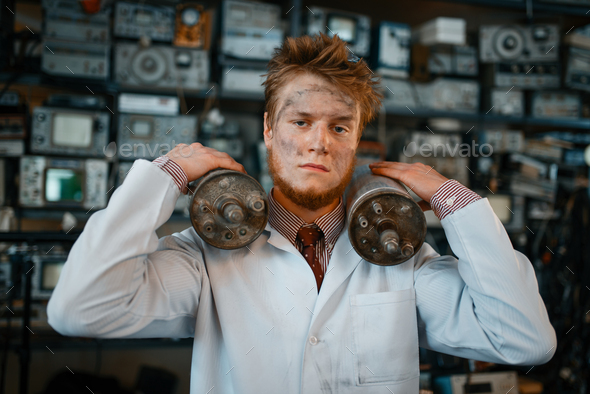 Scientist holds radiation devices in his hands - Stock Photo - Images