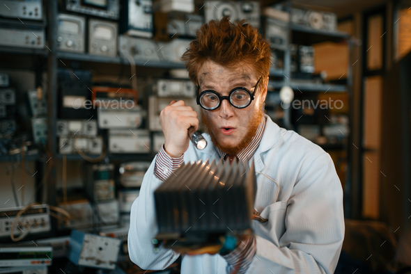 Strange engineer examines the cooling radiator - Stock Photo - Images
