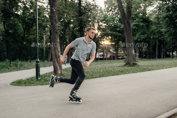 Roller skating, male skater rolling in action - Stock Photo - Images