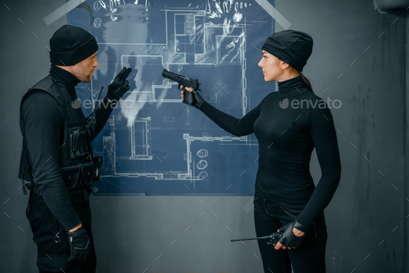 Two robbers working on a plan to rob the vault - Stock Photo - Images