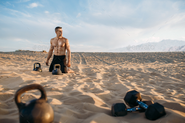Male athlete after workout in desert at sunny day - Stock Photo - Images