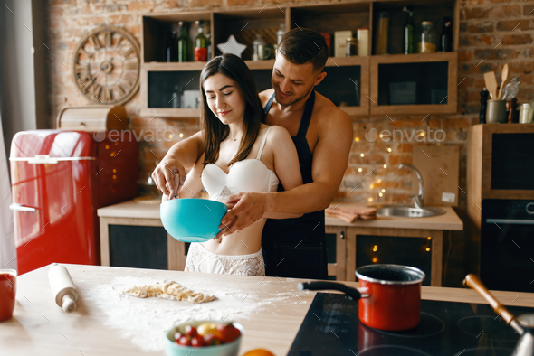 Love couple in underwear cooking, romantic morning - Stock Photo - Images
