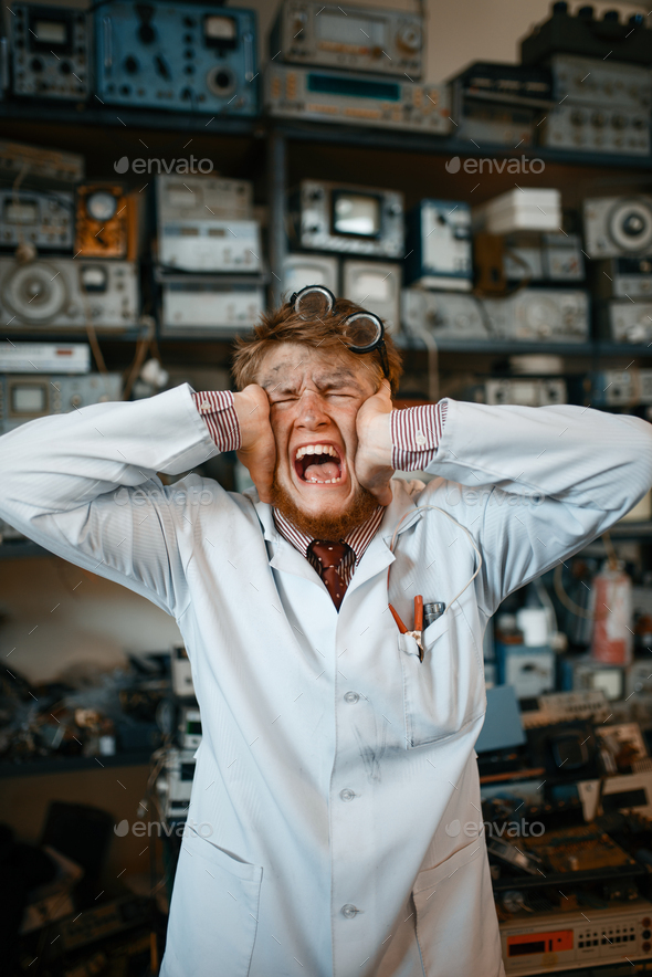 Strange scientist has gone mad in his laboratory - Stock Photo - Images