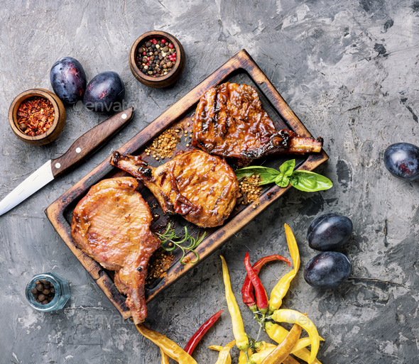Grilled meat in plum sauce - Stock Photo - Images