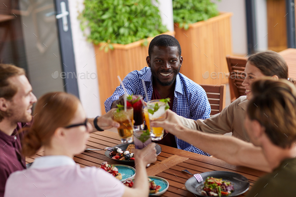 Friends Enjoying Cocktails in Cafe - Stock Photo - Images