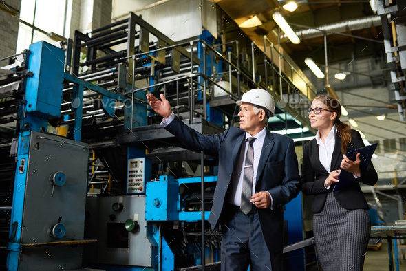 Senior Inspector Touring Modern Factory - Stock Photo - Images