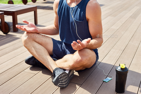 Handsome Man doing Yoga in Sunlight - Stock Photo - Images