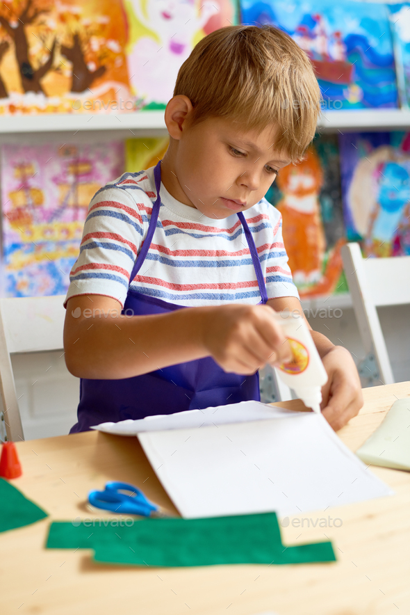 Little Boy Crafting in Class - Stock Photo - Images