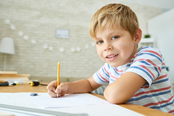 Good Little Boy Studying at Home - Stock Photo - Images