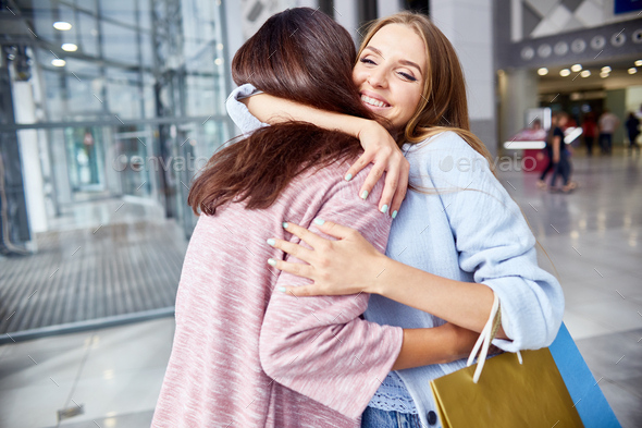 Girlfriends Meeting in Shopping Mall - Stock Photo - Images