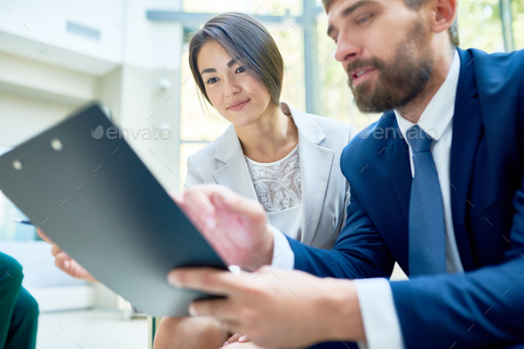 Sharing Business Ideas with Coworker - Stock Photo - Images