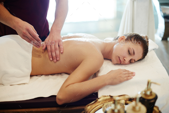 Young Woman Enjoying Massage in SPA - Stock Photo - Images