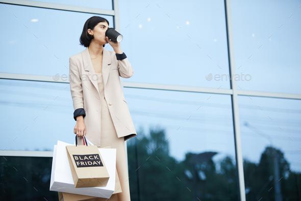 Elegant Woman Holding Shopping Bags - Stock Photo - Images