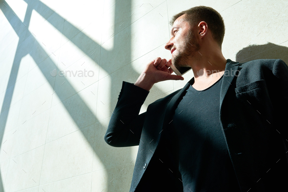 Handsome Man Speaking by Phone in Sunlight - Stock Photo - Images