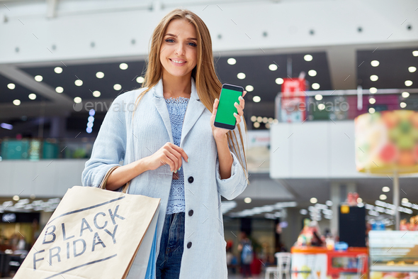 Young Woman presenting Shopping App - Stock Photo - Images