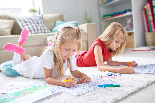 Little Girls Drawing on Floor - Stock Photo - Images