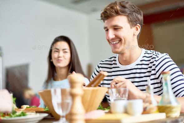 Happy Young Man at Dinner Table - Stock Photo - Images