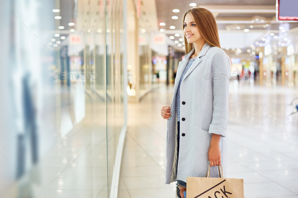 Pretty Woman Window Shopping in Mall - Stock Photo - Images