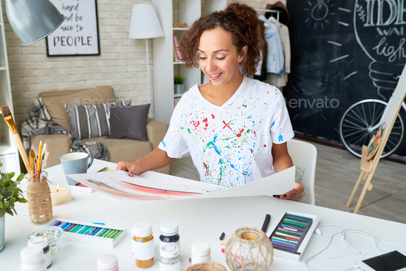 Happy Young Woman Painting at Home - Stock Photo - Images