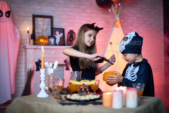 Children Playing during Halloween Party - Stock Photo - Images