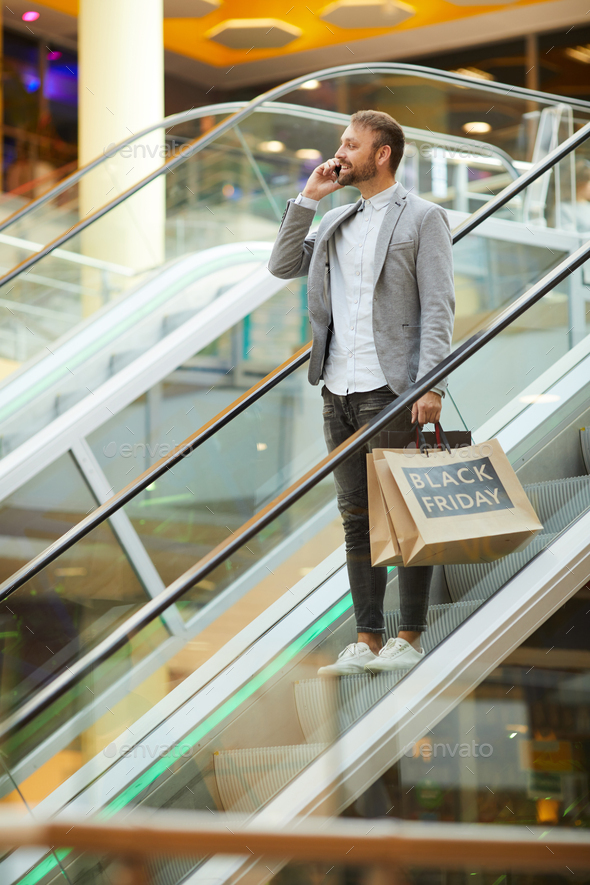 Handsome Man Speaking by Phone while Shopping - Stock Photo - Images
