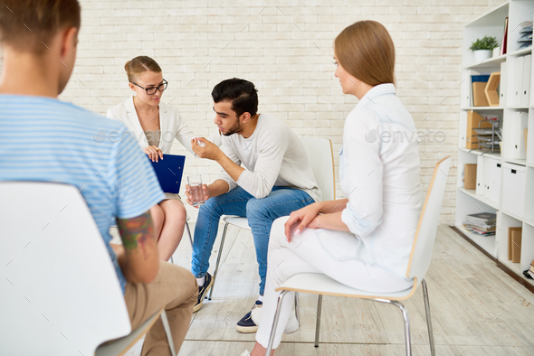Young Man in Group Therapy Session - Stock Photo - Images