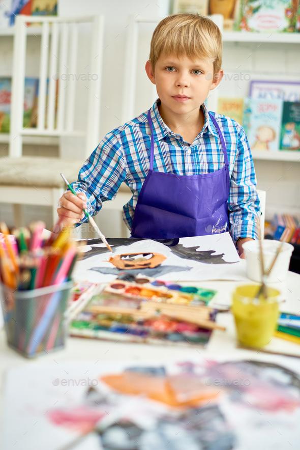 Blonde  Boy Posing in Art Studio - Stock Photo - Images