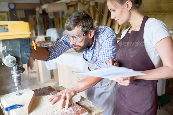 Two Carpenters in Workshop - Stock Photo - Images