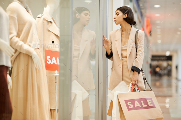 Young Woman Looking at Window Displays in Boutique - Stock Photo - Images