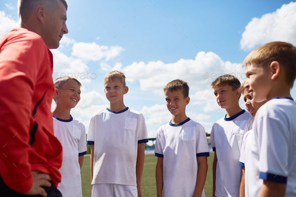 Coach Motivating Football Team - Stock Photo - Images