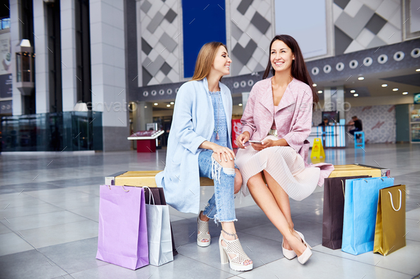 Two Girls Relaxing in Mall - Stock Photo - Images