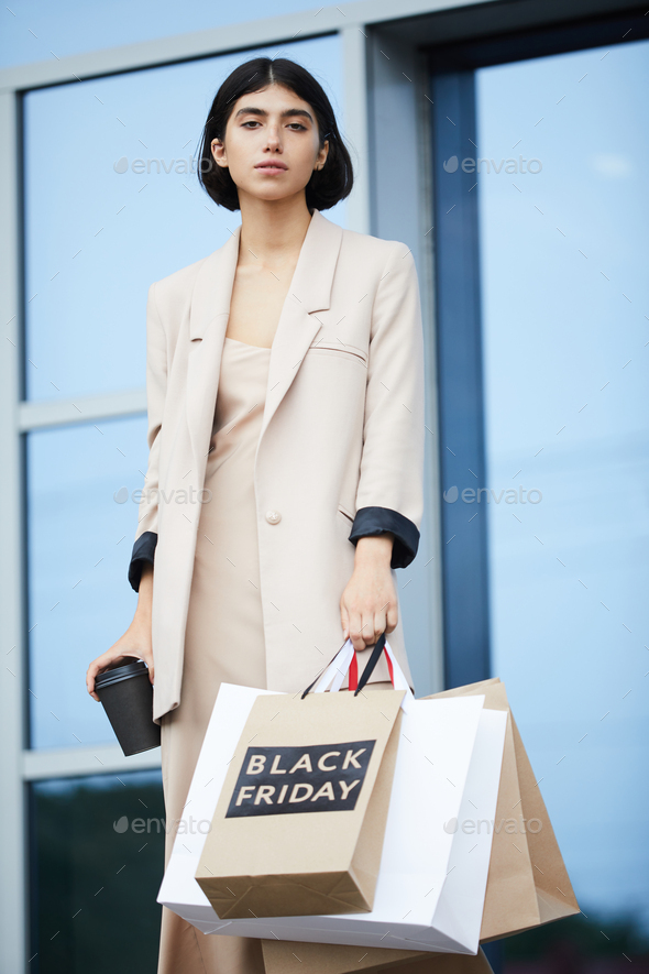 Elegant Woman Shopping on Black Friday - Stock Photo - Images