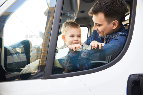 Father and Son in Car - Stock Photo - Images
