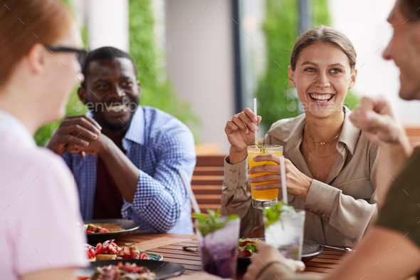 Cheerful Friends Enjoying Lunch Together - Stock Photo - Images
