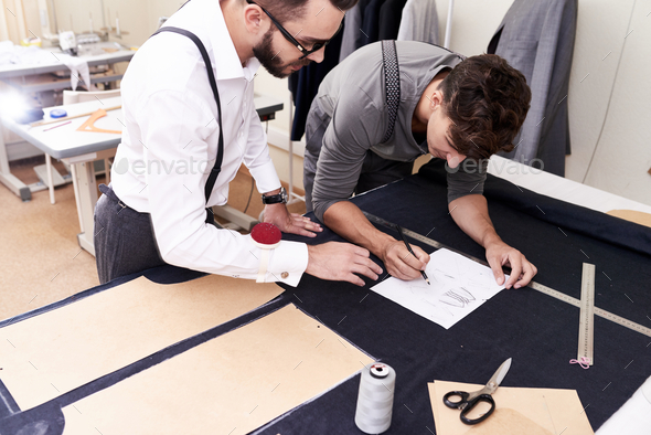 Two Tailors Working in Atelier - Stock Photo - Images