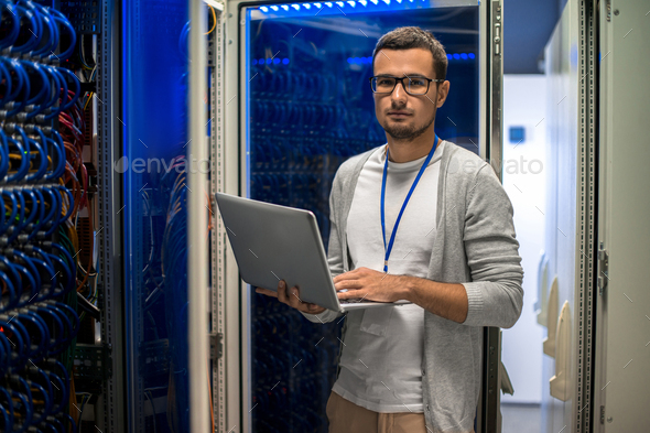 Network Engineer Managing Servers - Stock Photo - Images