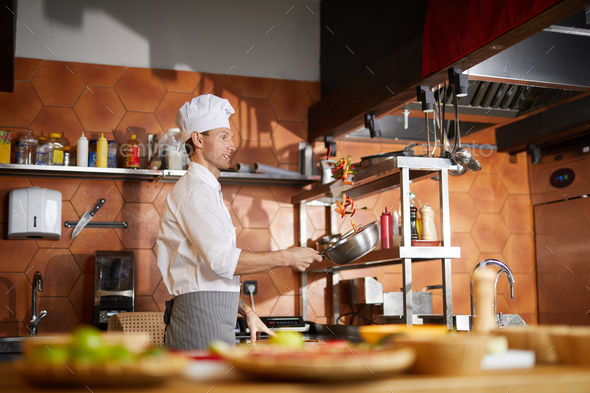 Chef Cooking Vegetables in Restaurant Kitchen - Stock Photo - Images