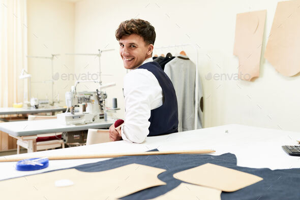 Cheerful Young Tailor in Workshop - Stock Photo - Images