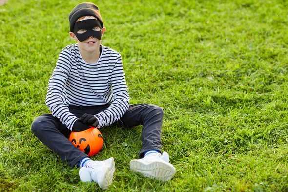 Little Boy Wearing Halloween Costume Outdoors - Stock Photo - Images