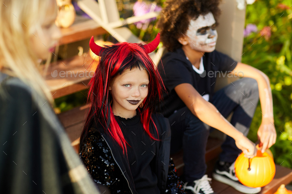 Little Girl with Friends on Halloween - Stock Photo - Images