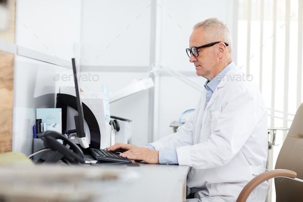 Senior Doctor at Workplace - Stock Photo - Images
