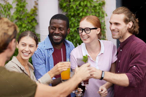 Friends Enjoying Drinks at Party - Stock Photo - Images